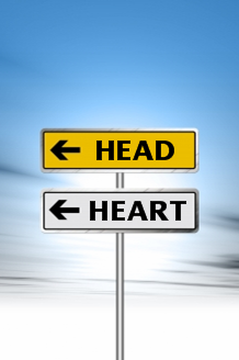 Road sign with Head and Heart pointing in the same direction